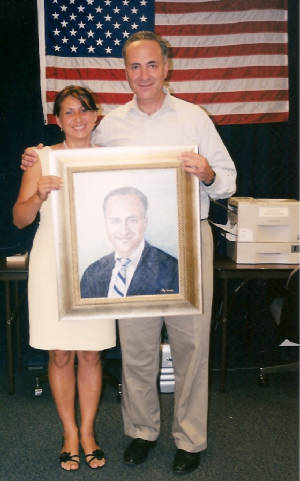 Leokadia and US Senator Schumer with his portrait